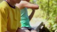 CU, TU, TD, couple of children (8-11) fishing sitting on wooden bridge, Bovina, New York State, USA