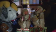 MS ZO Couple of monkeys playing fiddle and accordion in decorative window at christmas