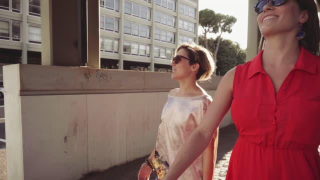 Couple of woman friends walking in Rome