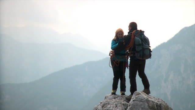 HD: Couple On A Mountain Peak