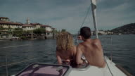 Couple on a Sailing boat, Lake Maggiore, Piedmont. Italy