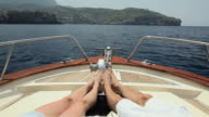 WS POV Couple on bow of motorboat / Port de Soller, Mallorca, Baleares, Spain