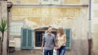 WS Couple on holiday walking through old streets / Valbonne, Provence, France