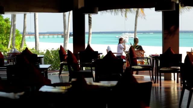 couple on restaurant beach terrace