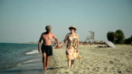 Couple on vacation, taking a walk at the beach.