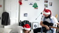 Couple playing a Christmas song