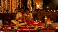 Couple preparing rangoli, Delhi, India