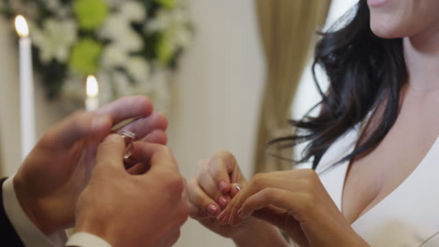 CU TU Couple putting wedding rings on each others fingers / Las Vegas,Nevada,USA