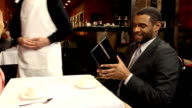 Couple Receives Guest Check Waiter