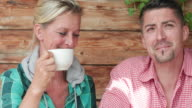 Couple relaxing in Chalet after walk in restaurant