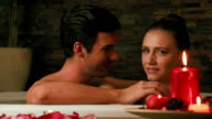 Couple relaxing in jacuzzi at beauty spa