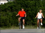 Couple riding bicycles outdoors