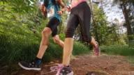 SLO MO CS Couple running a marathon on a forest trail