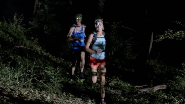 SLO MO Couple running in forest at night