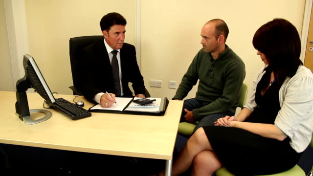 Couple sat in meeting with Financial advisor
