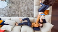 HA WS couple sharing digital tablet content on couch