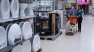 Couple shopping in a hardware store