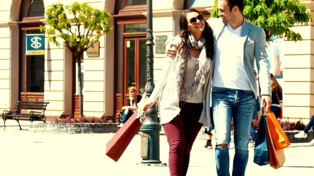 Couple shopping in slow motion.