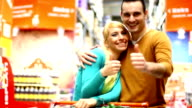 Couple shopping in supermarket.