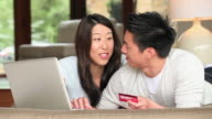 MS PAN Couple shopping online with credit card / Richmond, Virginia, USA