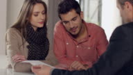 Couple signing contract for new apartment