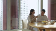 MS PAN Couple sitting at table, having breakfast together / China