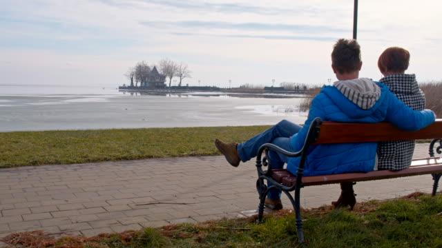 Couple sitting by the lake Balaton