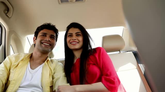 Couple sitting in the car, Delhi, India