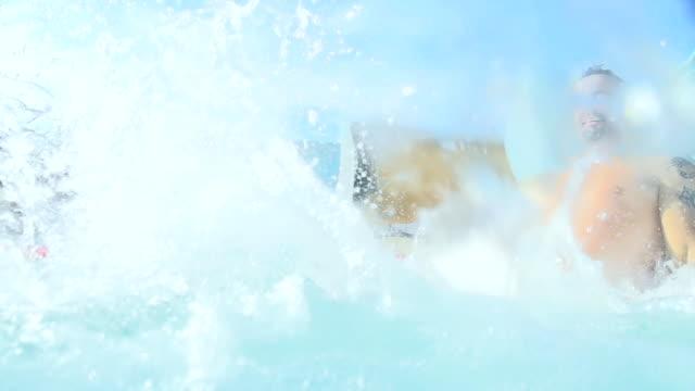 HD: Couple Sliding On Water Slide