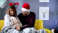 Couple snuggling with their cute dog
