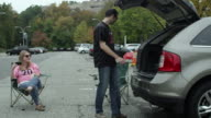 Couple Tailgating in parking lot