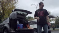 Couple Tailgating with barbecue