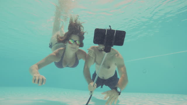 Couple takes a selfie underwater
