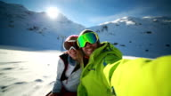 Couple taking selfie on ski slope