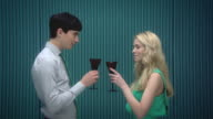 Couple toasting wine glasses and drinking