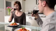 Couple toasting with wine and having meal