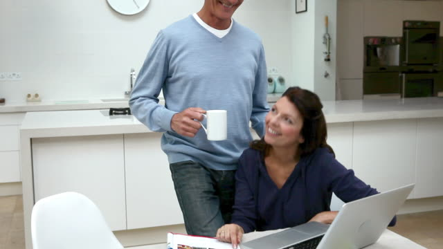 Couple using laptop to book holiday