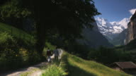 couple walking along a mountain trail
