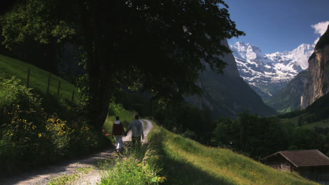 couple walking along a mountain trail