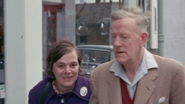 1972 MONTAGE Couple walking arm in arm, narrator discussing the importance of helping people who can't help themselves / United Kingdom