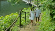 Couple walking in stairs in a garden