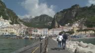 WS Couple walking on marina of Amalfi / Amalfi, Campania, Italy
