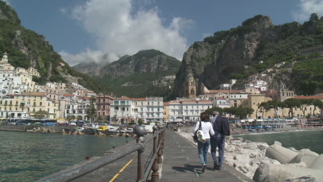 WS Couple walking on marina of Amalfi / Amalfi, Campania, Italy