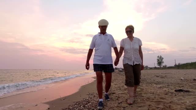 Couple walking. Slow motion.