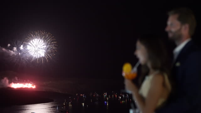 couple watching fireworks over caldera
