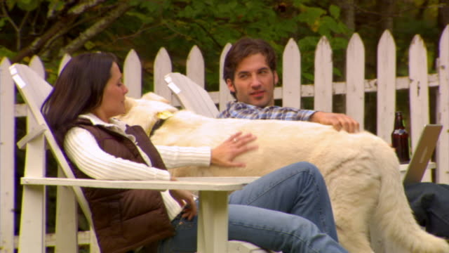 MS, Couple with dog relaxing in country house garden, Phoenicia, New York, USA