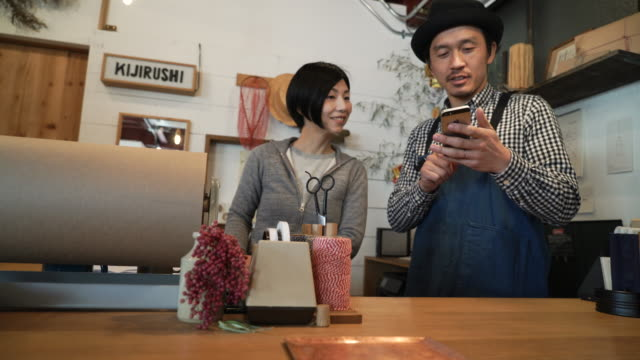 Couple working in a small general shop