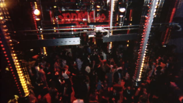 Couples dance in New York City's Studio 54.