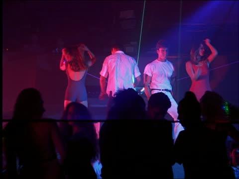 2 couples dancing in nightclub / Cancun