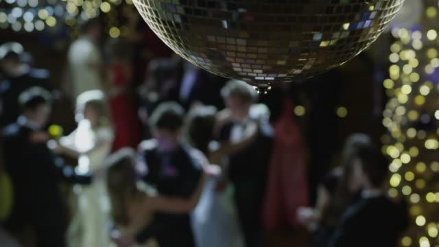 MS HA R/F Couples (12-18) dancing on prom night under disco ball / Cedar Hills, Utah, USA